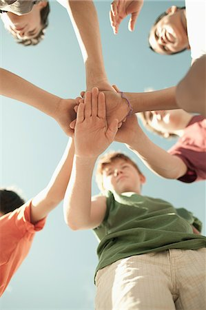 Boys doing huddle, low angle view Stock Photo - Premium Royalty-Free, Code: 6114-06600802