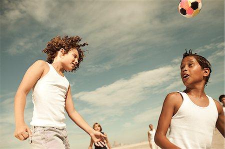 preteen boys playing - Boys heading football Stock Photo - Premium Royalty-Free, Code: 6114-06600808