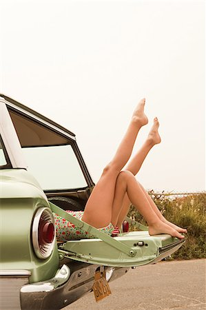 Two girls lying in estate car with legs in the air Stock Photo - Premium Royalty-Free, Code: 6114-06600949