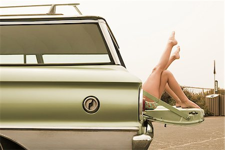 Two girls lying in estate car with legs in the air Stock Photo - Premium Royalty-Free, Code: 6114-06600950