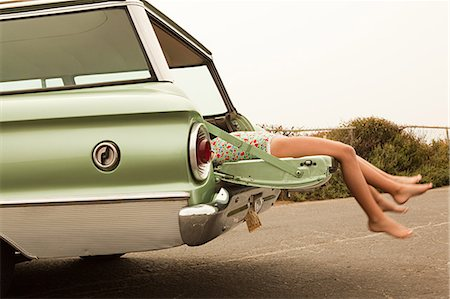 Two girls lying in estate car Stock Photo - Premium Royalty-Free, Code: 6114-06600951