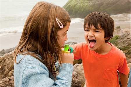 Children with lollipop, boy sticking out tongue Stock Photo - Premium Royalty-Free, Code: 6114-06600932