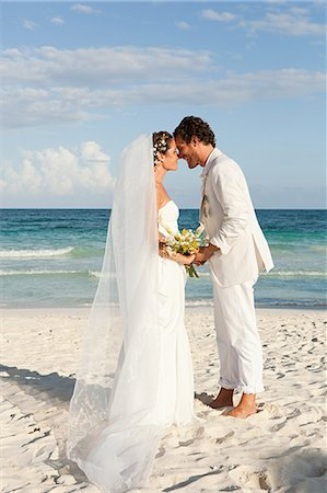 Bride and groom kissing on beach Stock Photo - Premium Royalty-Free, Code: 6114-06601095