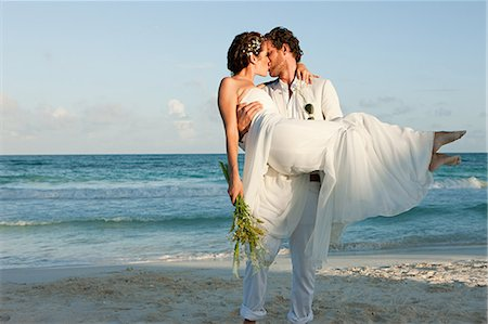 Bride and groom kissing on beach Stock Photo - Premium Royalty-Free, Code: 6114-06601241