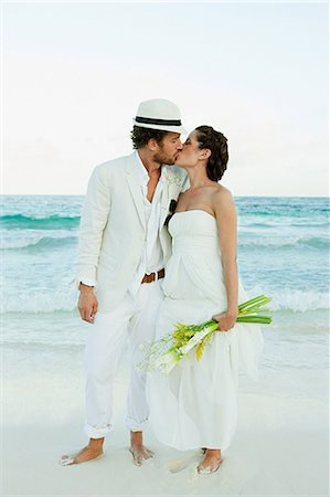 Bride and groom kissing on beach Stock Photo - Premium Royalty-Free, Code: 6114-06601200