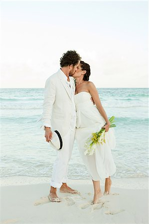 Bride and groom kissing on beach Stock Photo - Premium Royalty-Free, Code: 6114-06601233