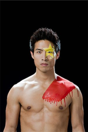 painted - Man with Chinese flag painted on face and shoulder Stock Photo - Premium Royalty-Free, Code: 6114-06601472