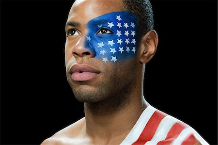 painted - Man with US flag painted on face and shoulder Stock Photo - Premium Royalty-Free, Code: 6114-06601415