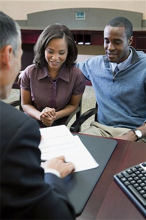Couple talking to bank manager Stock Photo - Premium Royalty-Free, Code: 6114-06601532