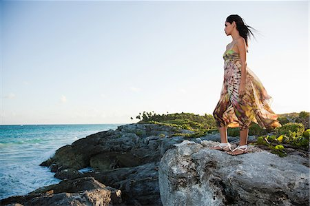 exotic outdoors - Young woman standing on rocks, Grande Cenote, Quintana Roo, Tulum, Mexico Stock Photo - Premium Royalty-Free, Code: 6114-06601646