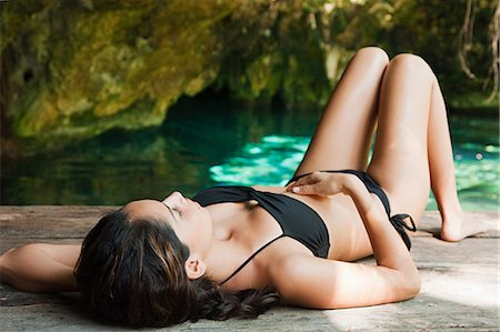 exotic outdoors - Young woman lying on jetty, Grande Cenote, Quintana Roo, Tulum, Mexico Stock Photo - Premium Royalty-Free, Code: 6114-06601649