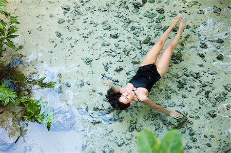 Young woman floating in lagoon, Grande Cenote, Quintana Roo, Tulum, Mexico Stock Photo - Premium Royalty-Free, Code: 6114-06601658