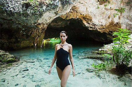 Young woman wearing swimsuit, Grande Cenote, Quintana Roo, Tulum, Mexico Stock Photo - Premium Royalty-Free, Code: 6114-06601662