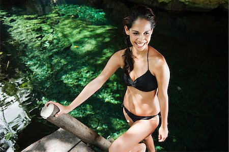 sexy black women in bikinis - Young woman on wooden ladder, Grande Cenote, Quintana Roo, Tulum, Mexico Stock Photo - Premium Royalty-Free, Code: 6114-06601665