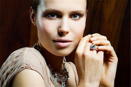 diamond - Young woman wearing ring, portrait Stock Photo - Premium Royalty-Free, Code: 6114-06601697