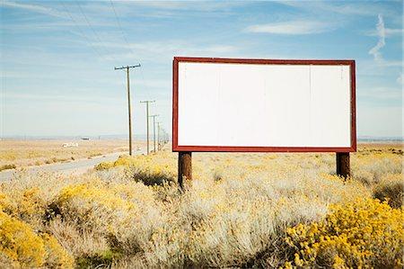 Blank billboard at roadside Stock Photo - Premium Royalty-Free, Code: 6114-06601627
