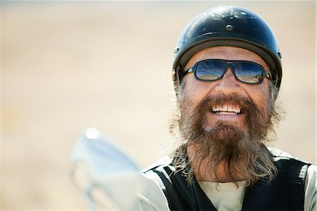 funky - Portrait of senior motorcyclist laughing Stock Photo - Premium Royalty-Free, Code: 6114-06601624