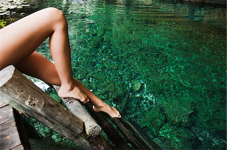 exotic outdoors - Young woman on wooden ladder, Grande Cenote, Quintana Roo, Tulum, Mexico Stock Photo - Premium Royalty-Free, Code: 6114-06601629