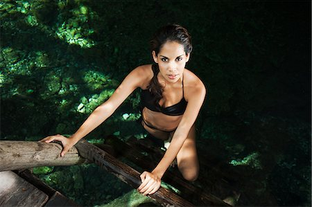 sexy black women in bikinis - Young woman on wooden ladder, Grande Cenote, Quintana Roo, Tulum, Mexico Stock Photo - Premium Royalty-Free, Code: 6114-06601634
