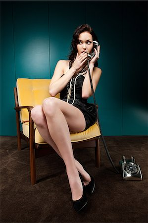 Young woman using vintage telephone Stock Photo - Premium Royalty-Free, Code: 6114-06601781