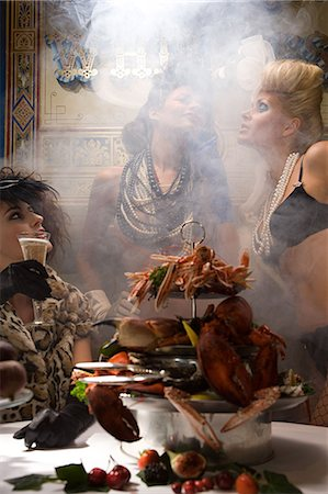 Three women with a feast of seafood Stock Photo - Premium Royalty-Free, Code: 6114-06602878