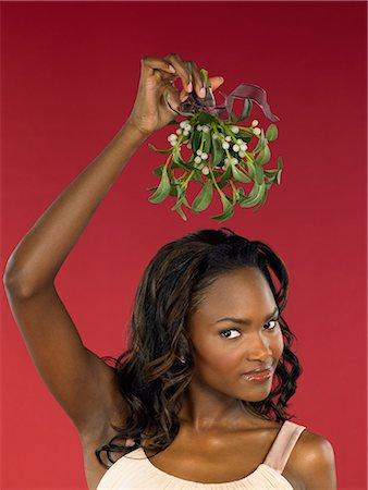 Woman holding mistletoe Stock Photo - Premium Royalty-Free, Code: 6114-06606241