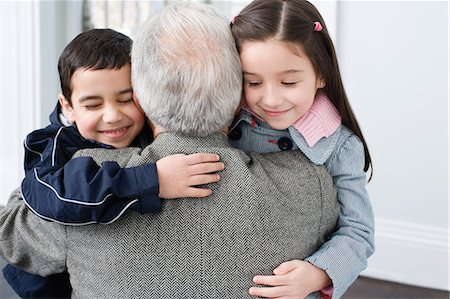 Brother and sister hugging grandfather Stock Photo - Premium Royalty-Free, Code: 6114-06606424