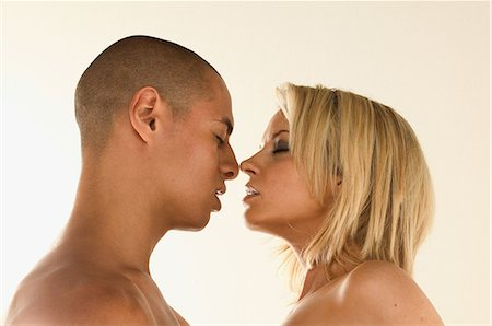 Young couple about to kiss Stock Photo - Premium Royalty-Free, Code: 6114-06607279