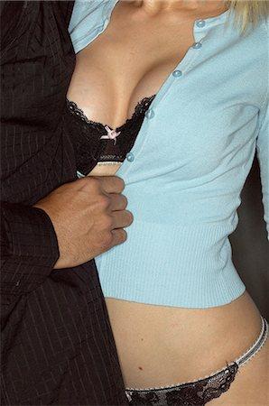 Lustful couple undressing Stock Photo - Premium Royalty-Free, Code: 6114-06607282