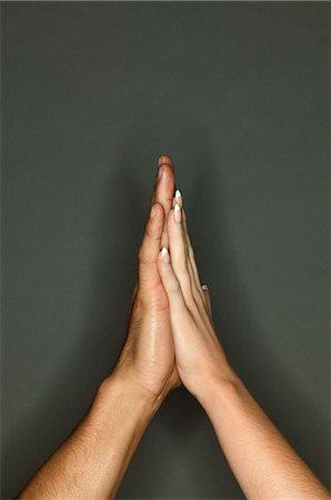 Couple touching hands Stock Photo - Premium Royalty-Free, Code: 6114-06607292