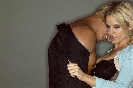 Lustful couple undressing Stock Photo - Premium Royalty-Free, Code: 6114-06607294