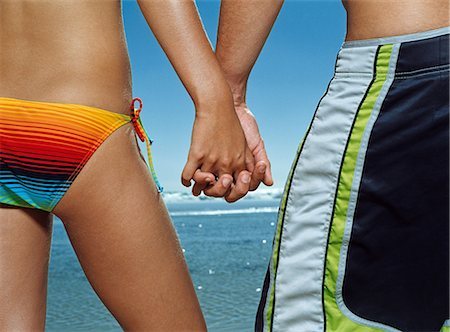 Couple holding hands on the beach Stock Photo - Premium Royalty-Free, Code: 6114-06607452