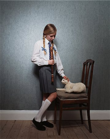 preteen girl pussy - Girl stroking stuffed cat Stock Photo - Premium Royalty-Free, Code: 6114-06607759