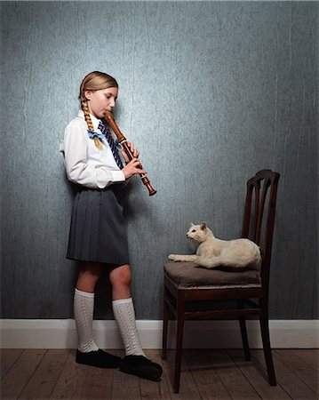 preteen girl pussy - Girl playing recorder to cat Stock Photo - Premium Royalty-Free, Code: 6114-06607739