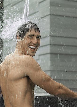 Man showering Stock Photo - Premium Royalty-Free, Code: 6114-06608212