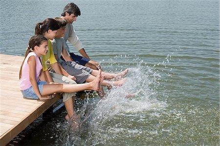 preteen girl feet - Family splashing feet in lake Stock Photo - Premium Royalty-Free, Code: 6114-06608428