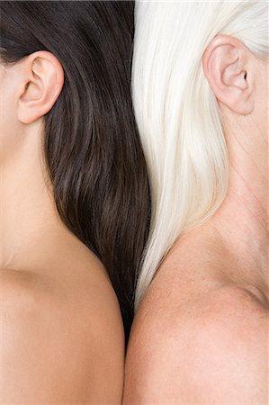 Women with dark and light hair Stock Photo - Premium Royalty-Free, Code: 6114-06609427