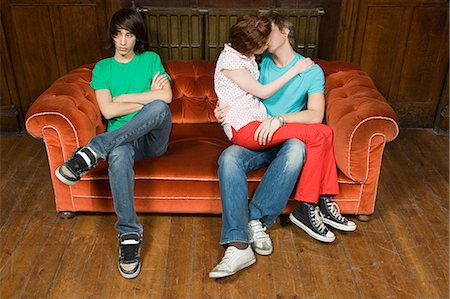 Jealous teenager with kissing couple Stock Photo - Premium Royalty-Free, Code: 6114-06609864