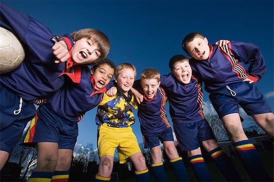 Portrait of a football team Stock Photo - Premium Royalty-Free, Image code: 6114-06610051