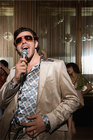 Retro man doing karaoke Stock Photo - Premium Royalty-Free, Code: 6114-06610950