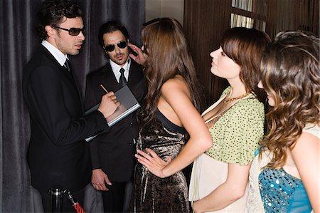 queue club - Women waiting to get into nightclub Stock Photo - Premium Royalty-Free, Code: 6114-06610959