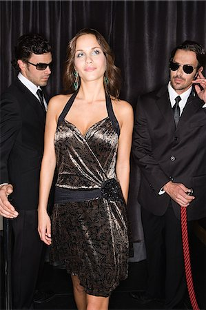 Bouncers admiring attractive woman Stock Photo - Premium Royalty-Free, Code: 6114-06610960