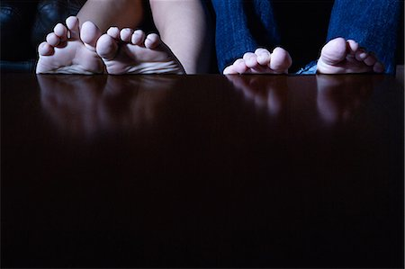 Feet on a table Stock Photo - Premium Royalty-Free, Code: 6114-06611382