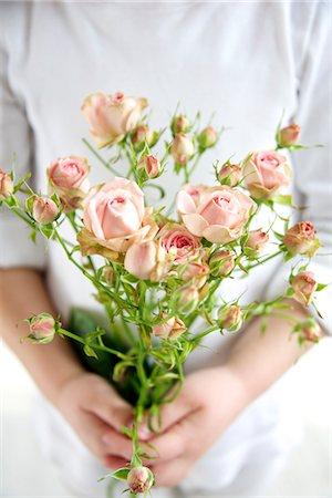 Child Holding Bunch Of Flowers, Munich, Bavaria, Germany, Europe Stock Photo - Premium Royalty-Free, Code: 6115-06778498