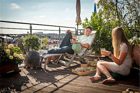 Couple Relaxing On Roof Terrace, Munich, Bavaria, Germany, Europe Stock Photo - Premium Royalty-Free, Code: 6115-06778656