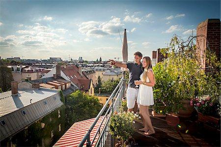Young Couple On Balcony, Munich, Bavaria, Germany, Europe Stock Photo - Premium Royalty-Free, Code: 6115-06778667