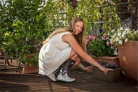 Woman On Balcony, Munich, Bavaria, Germany, Europe Stock Photo - Premium Royalty-Free, Code: 6115-06778666