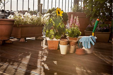 Flower Pots And Garden Tools On Balcony, Munich, Bavaria, Germany, Europe Stock Photo - Premium Royalty-Free, Code: 6115-06778675