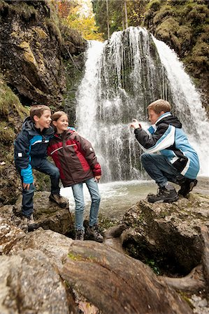 preteen girl boyfriends - Three Children In Front Of A Waterfall, Bavaria, Germany, Europe Stock Photo - Premium Royalty-Free, Code: 6115-06778787