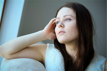 portrait looking away - Woman with brown hair, day dreaming, Copenhagen, Denmark Stock Photo - Premium Royalty-Free, Code: 6115-06778709